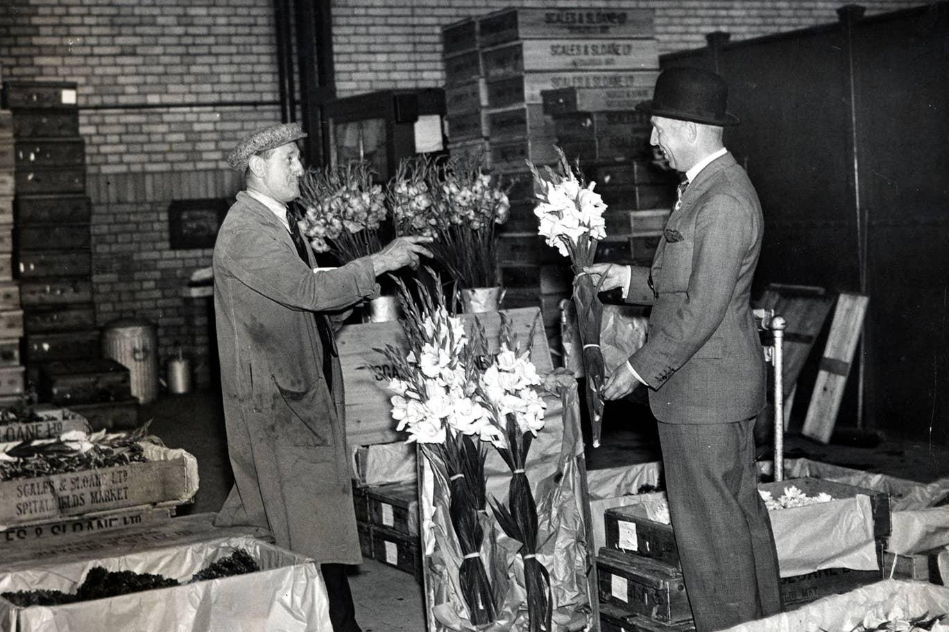 Businessmen buying flowers in spitalfields market